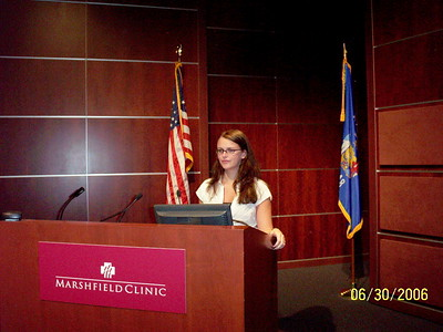 Angie at the Podium.  She was a case example for the chorea.  (c) APS Foundation of America, Inc.