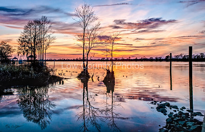 A winter evening sunset on the Waccamaw River as it flows by Pawleys Island in the Low Country of South Carolina.