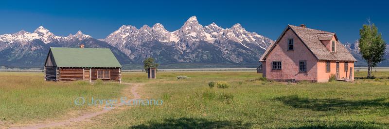 Mormon ranch and the Grand Teton range.