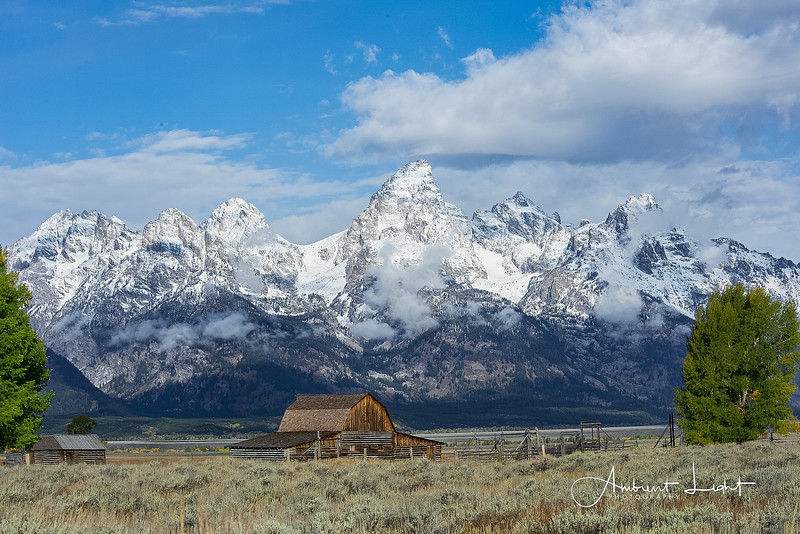 Iconic Corral Barn on Mormon Row with mighty Tetons