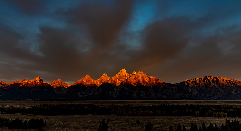 Alpenglow over the Grand Teton range at sunrise
