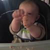 feeding himself peanut butter on bread