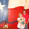 Tradition to have your picture taken in front of the Texas Flag and Rudy's sauce in Round Rock, TX