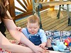 Mama Melissa with Adrian on back deck