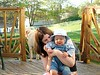 Mama Melissa with Adrian on back deck (Winston in the back)