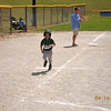 ASHLEY SCORING A RUN ON HER WAY TO HOME PLATE