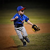 Photo of Zac playing shortstop and fielding a hard-hit grounder.