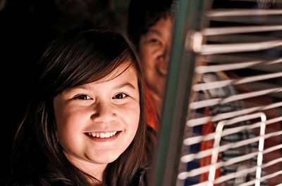 Ava by firelight at Benicia Tree Lighting