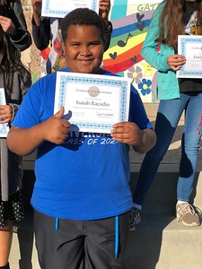 Isaiah with his Certificate of Achievement.