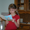 Brooke reading her cards.