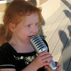 Sophie singing into her microphone - a birthday gift from her daddy.