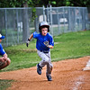 Zac breaks from third base on a line drive into left field. He raced home and scored!