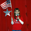 Brooke starts out waving the flag as she sings.