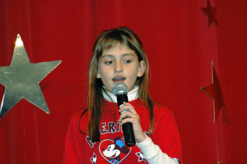 Actually, she gets her singing talent from her Papa....If you believe that I have a bridge FOR SALE.