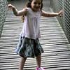 Chloe on the wobbly bridge - Alnwick Gardens Tree House
