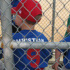 Waiting to bat in the dugout