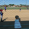 Catelyn watches her big brother play ball.