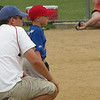 Christian and dad watching the batter!