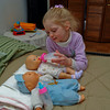 Speaking of dolls, Katie is a very good mommy to her dolls.