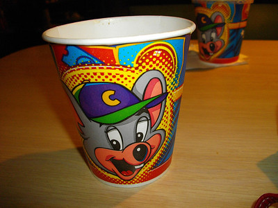 Chuck E. Cheese cup full of root beer.
