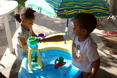 Jaylie and Isaiah playing with the new water toy.