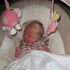 Baby Claire in her swing.
