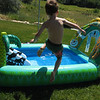 Asher making a giant leap into the pool.