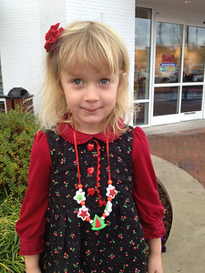 Thalia wearing the cute little cherry print dress I made for her last year.  I'm so glad she can still wear it.