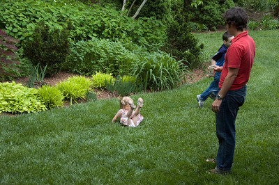 Thalia and Todd play in the grass