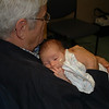 Granddaddy holding the very sick Johnny, February, 2008.