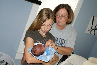 Aunt Hannah holding me for the first time