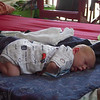 Justin on porch about 10 day old