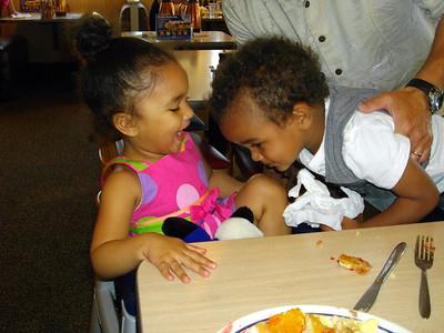 Isaiah kissing Jaylie's owie.
