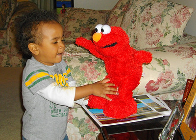 Isaiah having fun with Elmo.