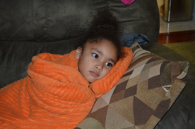 Jaylie relaxing while watching TV.