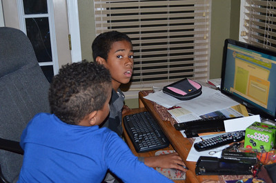 Isaiah and Noah on the computer.