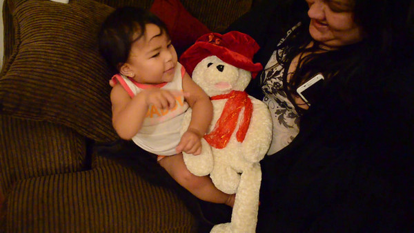 Video on Kaylanni on Missy's lap and enjoying a playing doll.  She dances with hre hands during the music.