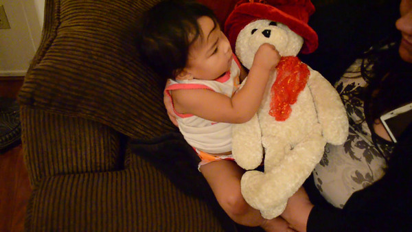"""Video of Kaylanni playing with the singing bear.  She makes the sign language sign for """"more"""" when the music runs out."""