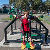 Leo building muscles at the park opposite his school