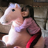 The postman found this horse discarded at a nearby daycare center and brought it over for Makiyah