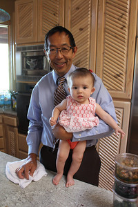 Harvey holding Malia