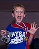 Jacob(11) with soccer tournament medals.  Shot indoors with Betterbouncer on flash.