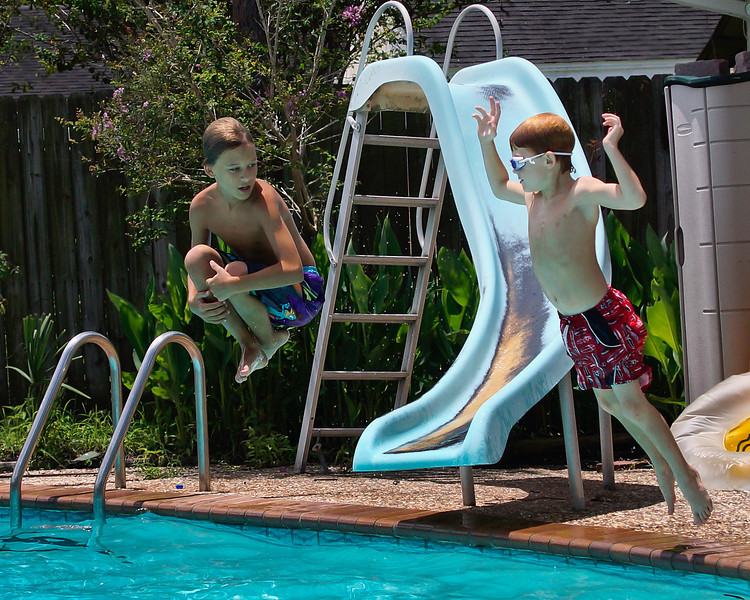 Jacob(11) and Josh(7) doing simultaneous cannonballs.