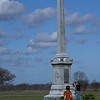 Grandsons Josh(8) taking photo and Jacob(12) walking up to the obelisk at the Fannin battlefield memorial in Fannin, TX.