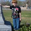 Grandson Josh at the monument in the Fannin Battlefield Memorial in Fannin, TX.