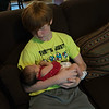 Grandson Josh holding sister's great great granddaughter, Chloe.