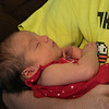 Sister's great great granddaughter, Chloe, in arms of my grandson, Josh.