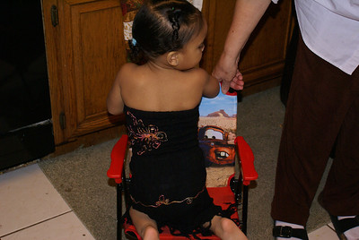Jaylie in her pretty black dress in the kitchen.