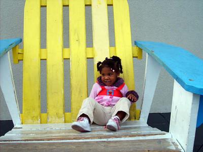 Kyra Sitting in big chair