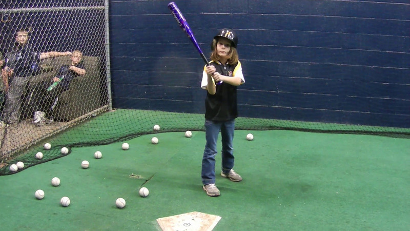 Natalie takes batting practice at the Pirates batting cage inside PNC Park.